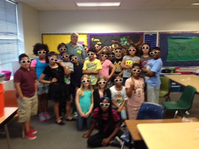 Dr. Ed Buskey takes marine science and UTMSI sunglasses to the 4th grade class of Pershing Park Elementary at Fort Hood.